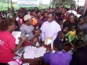 Father Mbaka Continues His Charity Work For The Poor, Gives Them Cheque (Photos)
